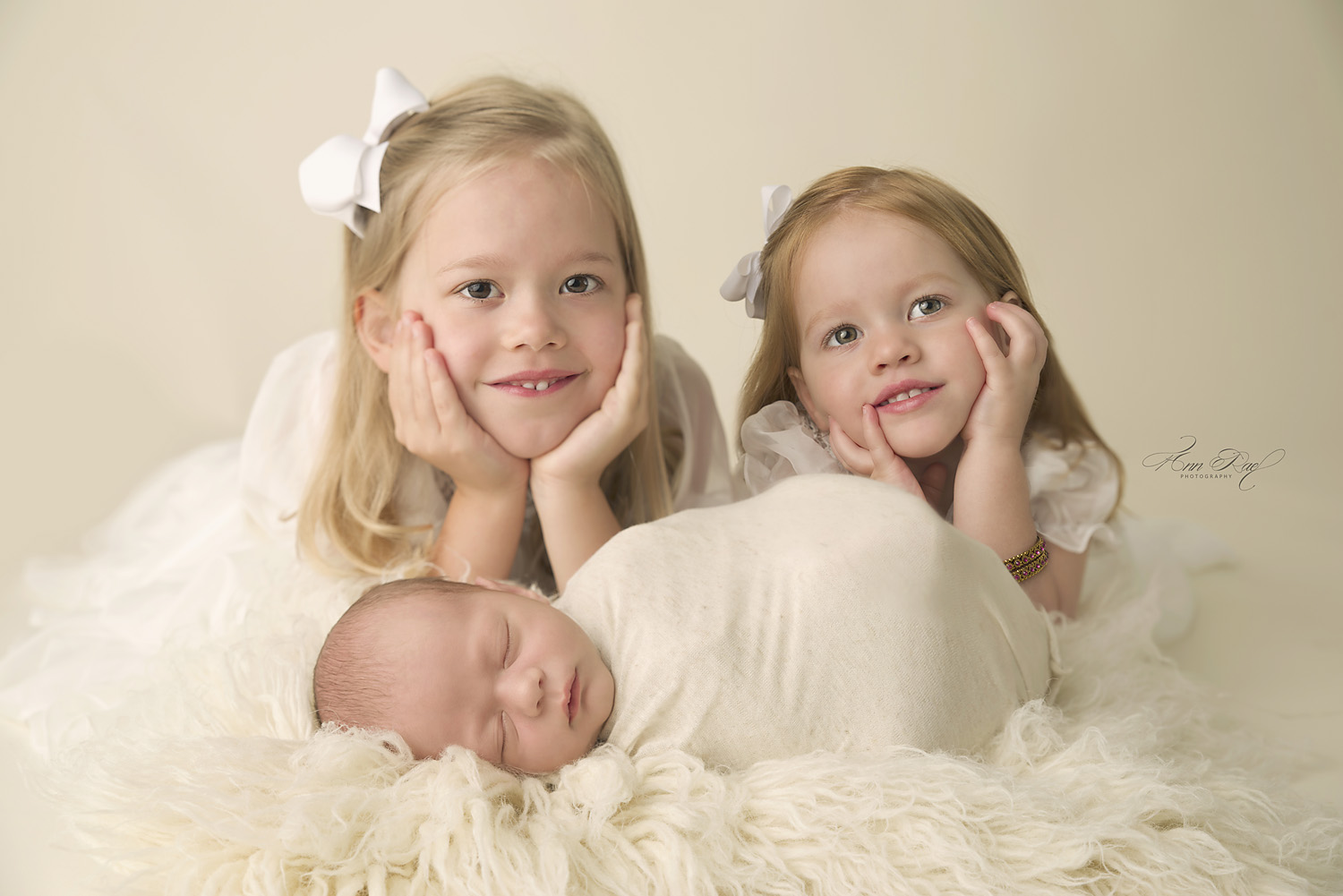 Newborn portfolio with big sisters