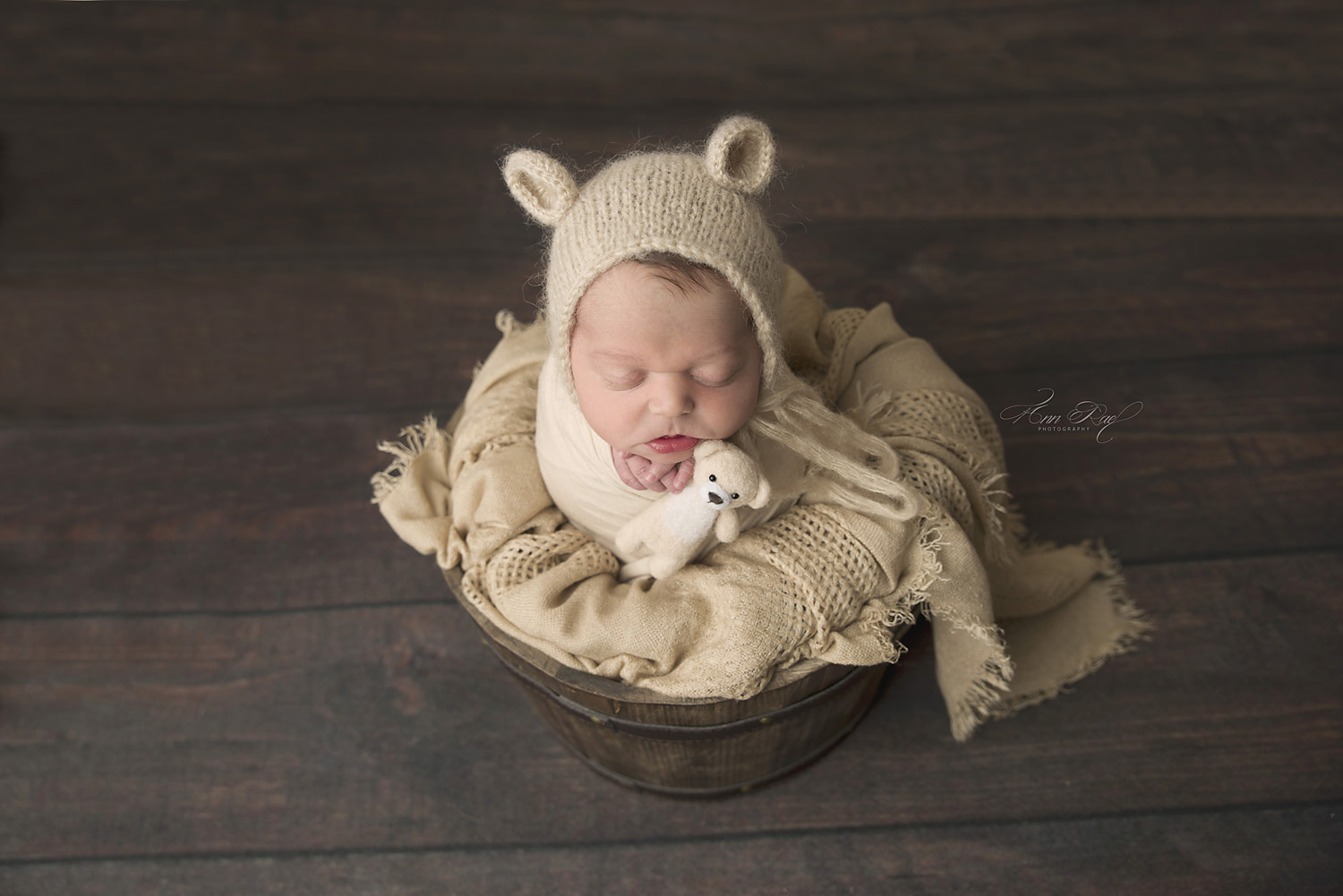 St. Louis Newborn Photographer wears a little bear outfit