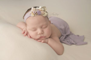 Newborn Session with Baby wearing purple headband in st. louis