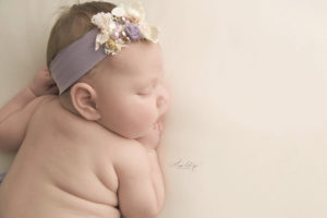St. Louis Newborn Session Picture of baby with a lavender headband