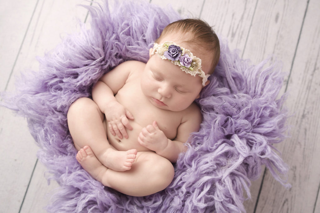 Newborn Session with a St. Louis Baby in a sweet newborn pose