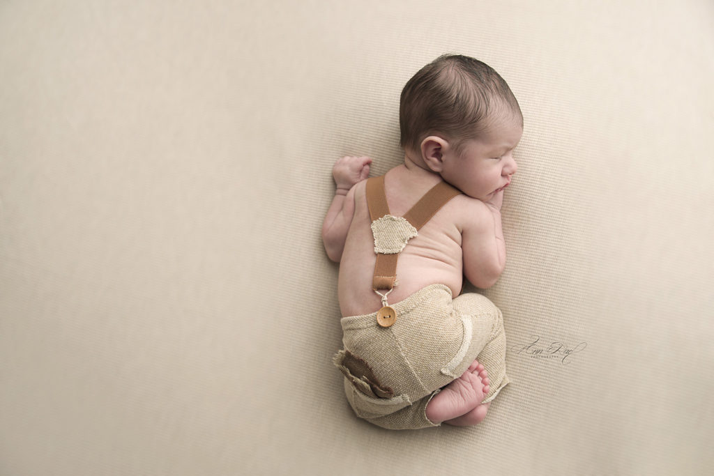 Newborn Session in St. Louis Sweet little boy with cute pants