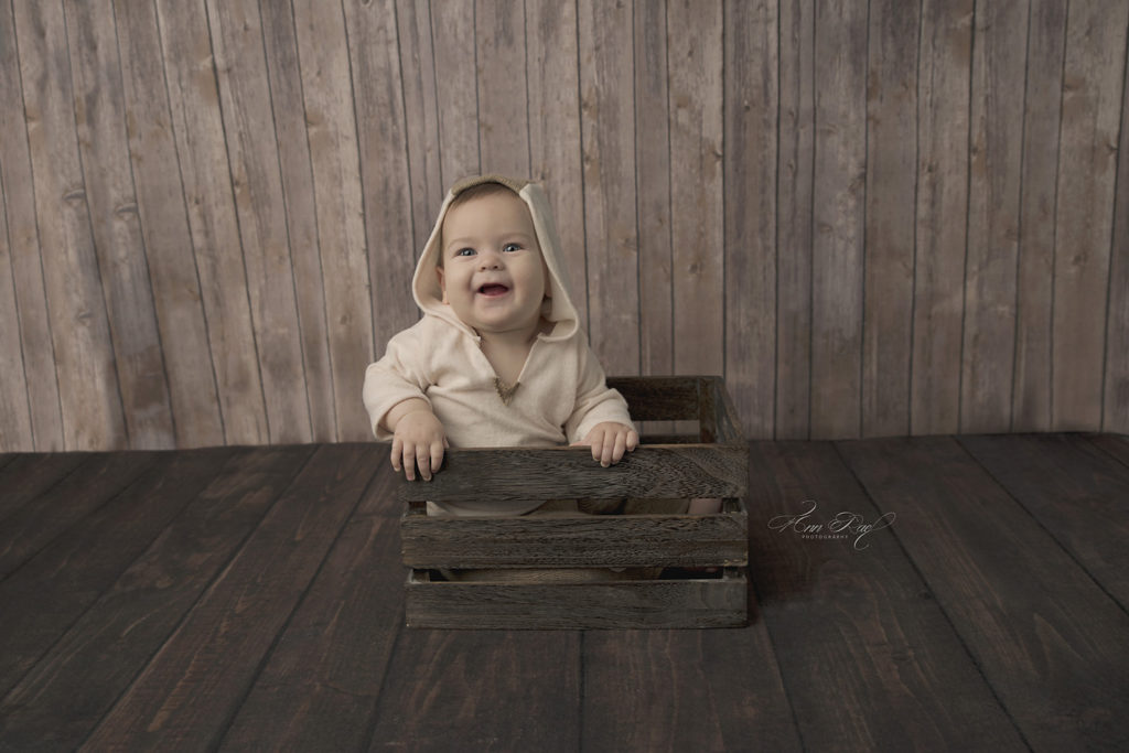 St. Louis Baby getting pictures in Photography Studio