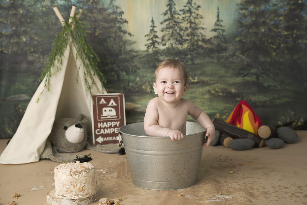 St. Louis Baby Photographer getting clean after a messy cake smash