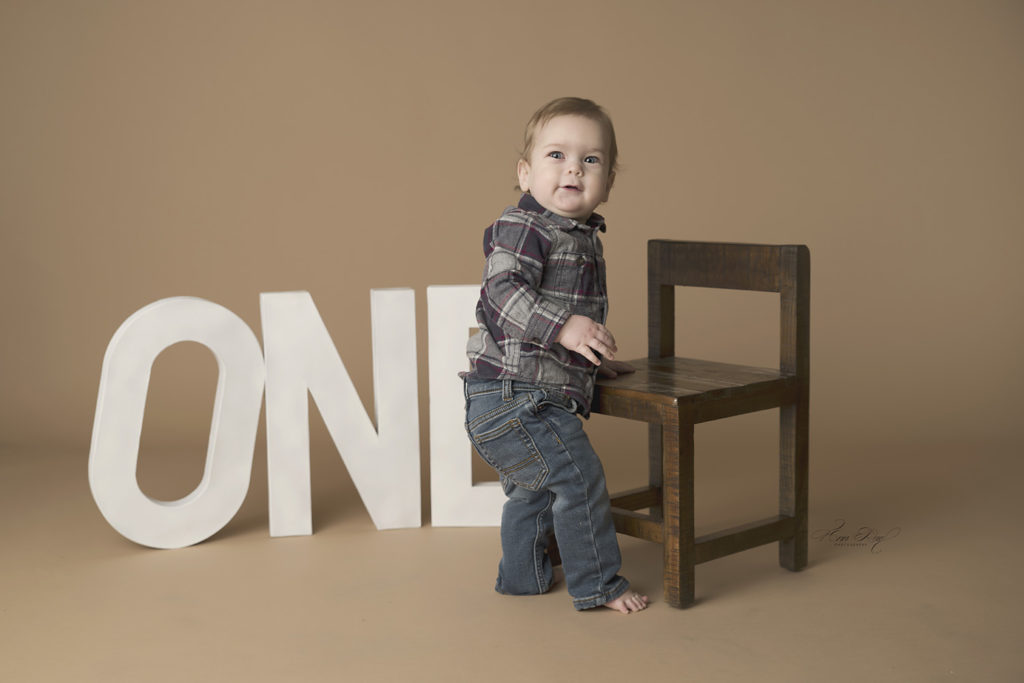 Baby boy turns one and goes to St. Louis Baby Photography for portraits
